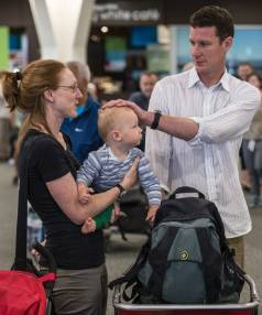Duncan Kemsley, Heather Smith and their son, Jeremy Kemsley, at Christchurch Airport on Friday.