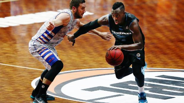 Cedric Jackson, who had a team-high 16 points for the Breakers, drives past Adelaide's Adam Gibson.