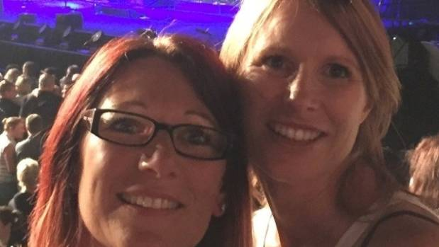 Jo Pert at a Robbie Williams concert with her cousin.
