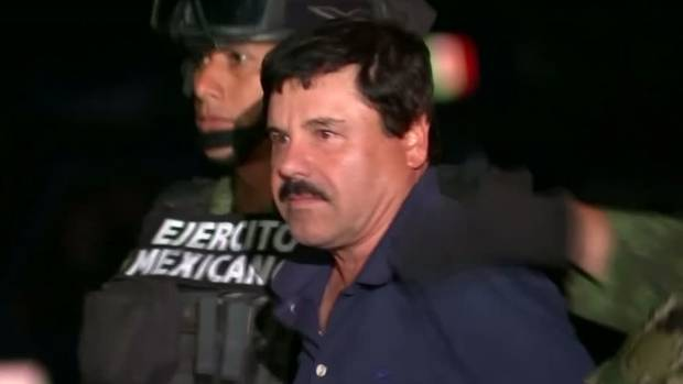 """Mexican police present the world's top drug lord Joaquin """"El Chapo"""" Guzman to the media, after recapturing him following ..."""