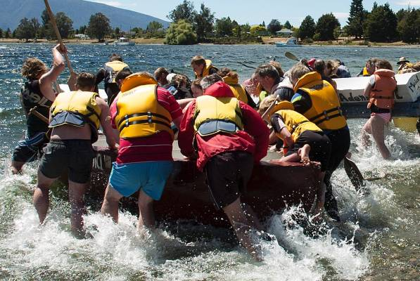 The boats take back in the cardboard boat race at Te Anau on Saturday.
