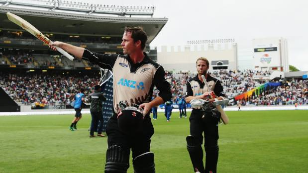 Colin Munro acknowledges the crowd after hitting a six for victory