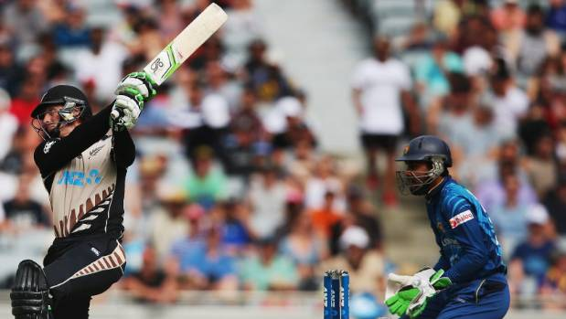Martin Guptill unleashes another huge six during his batting blitz.