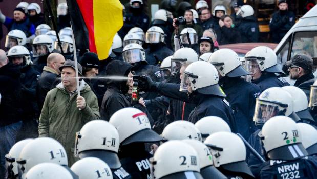 Police use pepper spray to control supporters of Pegida, Hogesa (Hooligans against Salafists) and other right-wing ...