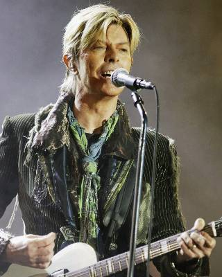 David Bowie performing on the final day of The Isle of Wight Festival 2004 in the UK.