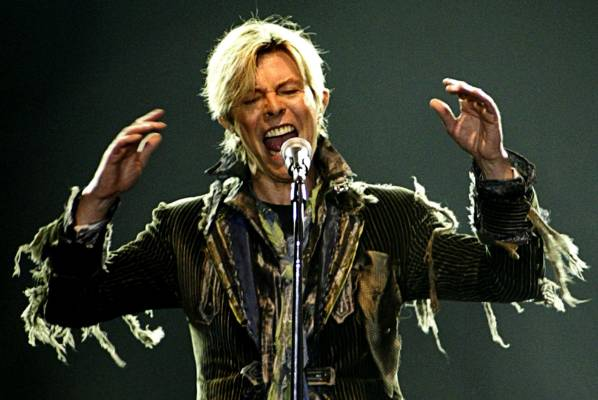 David Bowie performs in a concert during his worldwide tour A Reality Tour in Prague, June 2004.