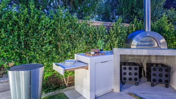 Cooking facilities include a Zesti stainless steel pizza oven and Eva Solo stainless steel charcoal barbecue.