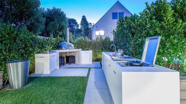 The outdoor kitchen is minus walls and a roof, but it has most things a modern indoor kitchen provides, including a ...