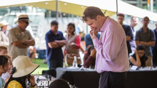Chess grandmaster Nigel Short ponders his next move in Auckland's Aotea Square.