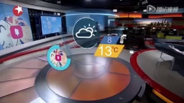 At Dragon TV, viewers are shown a shot of an empty studio, while weather graphics on a screen augment Xiaoice's forecast.
