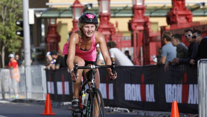 Auckland resident Victoria Taylor races through Auckland during the 70.3  half Ironman race in Auckland in b962d7e7e