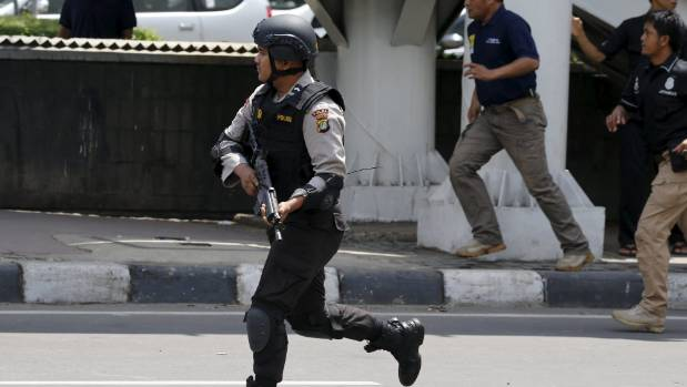 An Indonesian policeman near the site of the blasts.