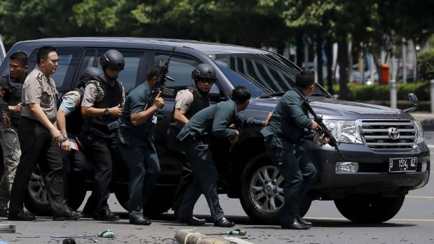 Indonesian police hold rifles as they respond to the attack.