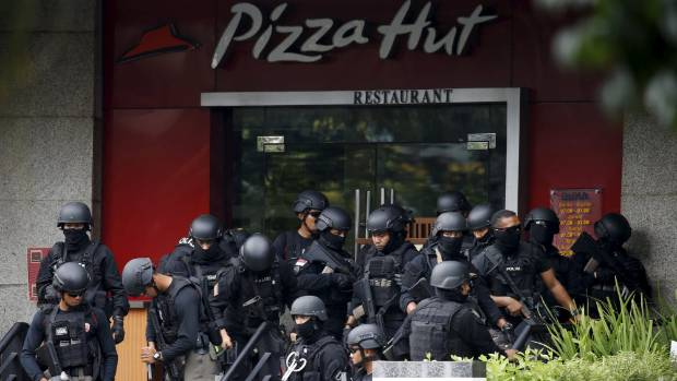 Police gather outside a Pizza Hut outlet near the scene of the attack in central Jakarta.