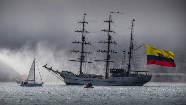 Tug boats welcome Ecuadorian tall ship the Guayas into a fog-bound Wellington harbour early on Sunday evening after ...