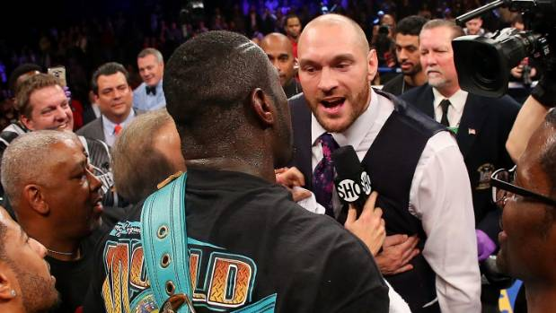 Deontay Wilder is confronted by Tyson Fury after a fight in New York.