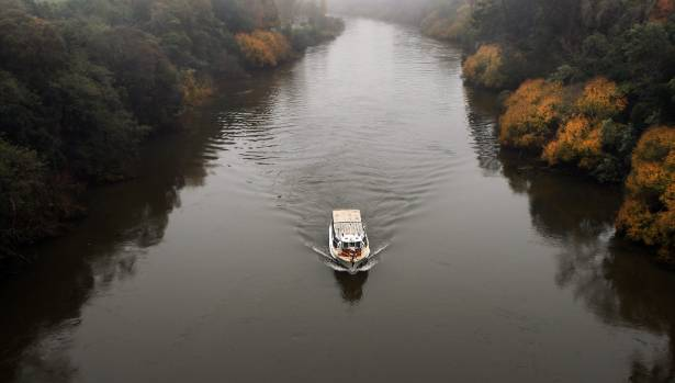 The Waikato River Explorer tour chugs upstream.