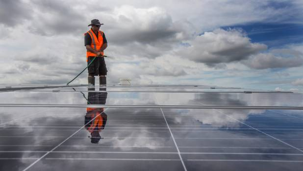 Pascal Temu gives the solar panels on top of Sylvia Park shopping centre their first clean.