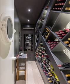 Kitchen designer Robin Caudwell designed this wine cellar, integrating the cubbies with the structural bracing of the house.