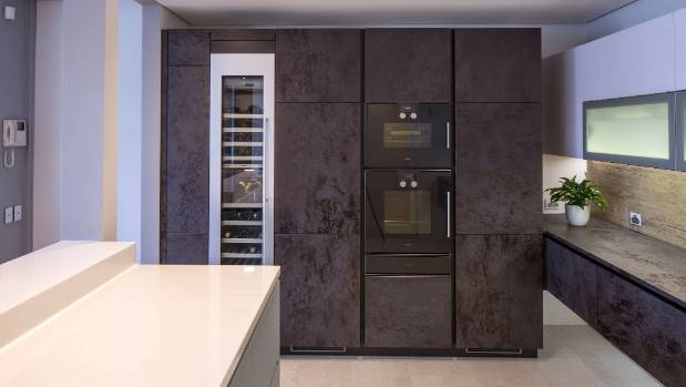 This high-end Alno Cera kitchen designed by Damian Hannah of German Kitchens features a Gaggenau 450mm-wide wine cabinet ...