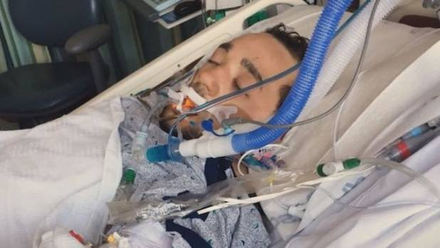 Justin Smith was lying in the snow for nearly 12 hours. A year later, he is alive and well.