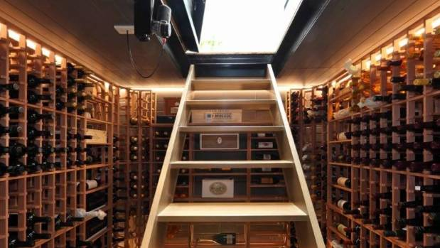 The glass trap door opening up to this expansive wine cellar is in the kitchen floor of a traditional villa remodelled ...