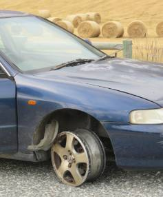The Honda Integra involved in the police pursuit, with no front tyre after hitting police spikes.