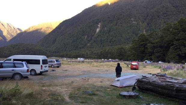Campers on the road to Milford Sound. Up to 500 people camp overnight at sites along the road in high season.