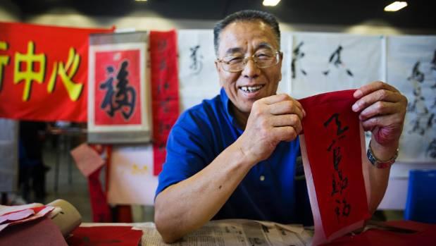 Calligrapher Lianxi Sun displays his work.