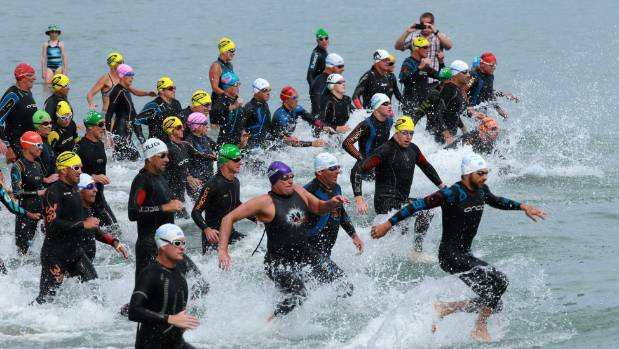 Competitors get started during Sunday's Ironman distance swim from Tahunanui Beach.