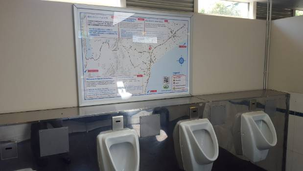 A South Canterbury public toilet with one of the region's new road crash maps with messages for tourists