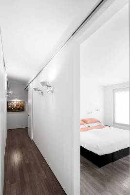 Sleek white walls also reflect the limited material palette.