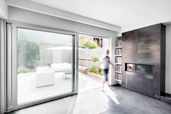 Striking black house renovation hints at modern interior for Sliding glass doors nz