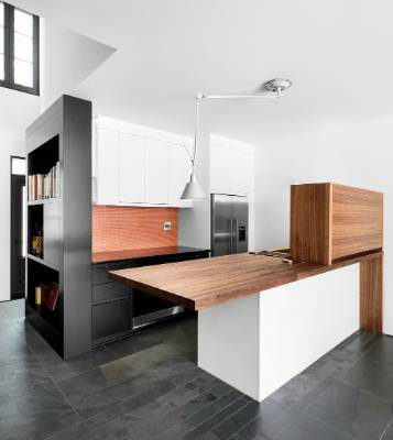 White and black cabinets are teamed with natural timber accents in the kitchen.