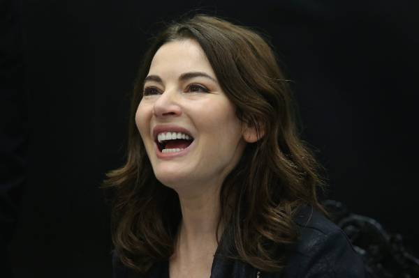 Nigella Lawson laughs during Paper Plus book signing event at H & J Smith in Invercargill on Tuesday afternoon.