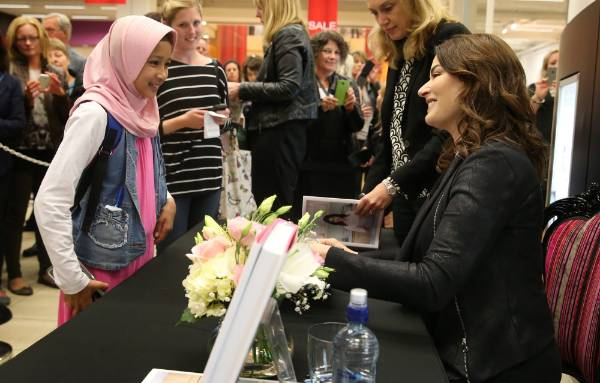Hafsha Abdul-Jabbar, 11, of Mokotua, has her cook book signed by Nigella Lawson at Paper Plus Invercargill on Tuesday.