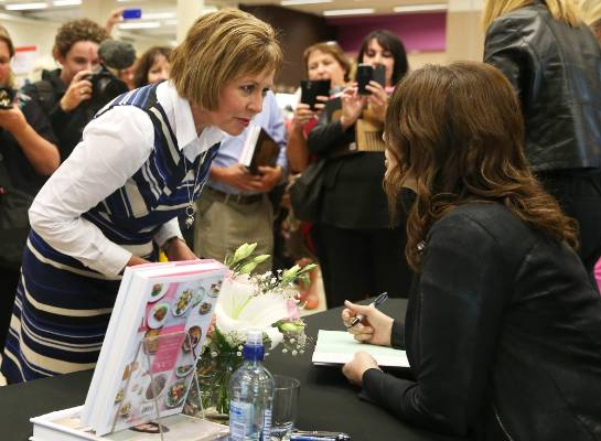 Bronwyn Sadler, of Invercargill, has her book signed by Nigella Lawson after a two-and-a-half-hour wait at Paper Plus ...