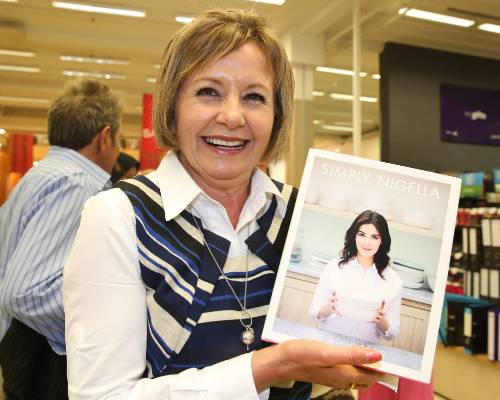 Bronwyn Sadler, of Invercargill, with her book, signed by Nigella Lawson, at Paper Plus Invercargill on Tuesday.