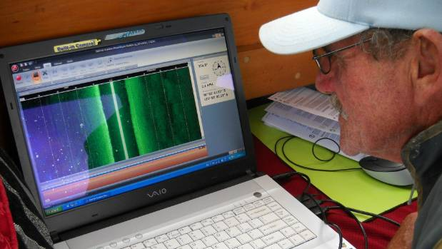 Noel Hilliam views scanned images of the depths of the  Northern Wairoa River in his search for the missing P-51 Mustang.