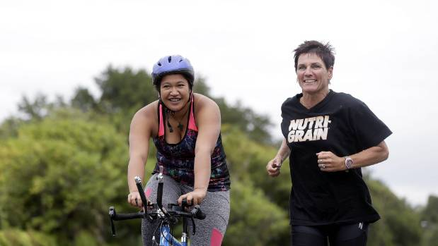Erica Green trains for an Ironman while Erina Tohiariki provides support.