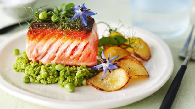 Five easy entrees to get your dinner party off to a great start serve salmon on a mound of pesto forumfinder Gallery