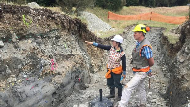 GNS Science earthquake geologists Pilar Villamor and Robert Langridge studying layers in the trench across the Alpine ...