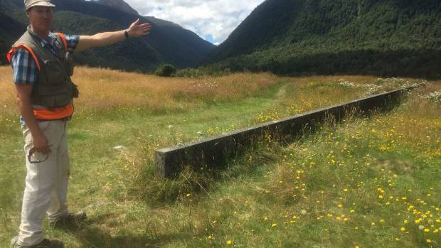 GNS Science earthquake geologist Robert Langridge at the wall which was built across the Alpine Fault in 1964 at Springs ...