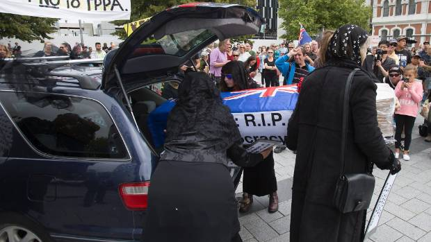 """Anti-TPPA protesters staged """"democracy's burial during a rally in Cathedral Square on Saturday."""