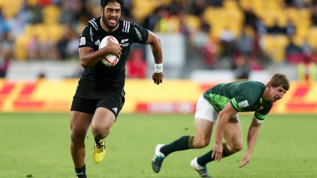 Akira Ioane of New Zealand beats the tackle of Kwagga Smith of South Africa during the 2016 Wellington Sevens cup final ...