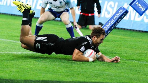 New Zealand's Joe Webber dives over to score the tournament winning try against South Africa.