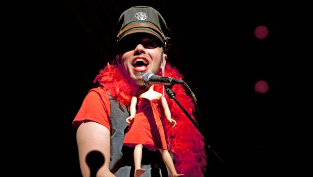 Hawksley Workman in his show, The God that Comes.
