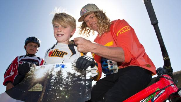 Kelly McGarry, professional free-rider, signs Cody Waters' top during the Crankin' with Kelly event at the Nelson BMX ...