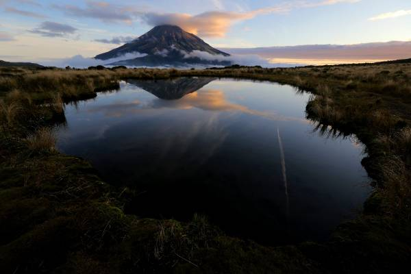 Situated roughly two hours from the Mangorei Rd end of the Pouakai crossing the tarn (mountain lake) reflection is a ...