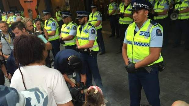 Protesters face police at Sky City in Auckland.